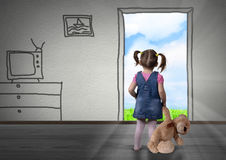 Child girl in front of the drawn door, back view. Way out concep Royalty Free Stock Image