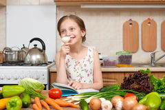 Child girl with fruits and vegetables in home kitchen interior, Stock Photos