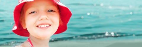 Child girl fun sea beach summer vacation. Panorama banner background Stock Photos
