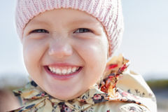 Child girl funny face happy smile. Closeup outdoor Stock Photography