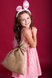 Child girl with gift bag is wearing bunny ears Royalty Free Stock Photos