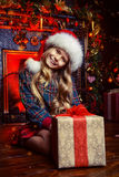 Child girl with a gift Stock Photos