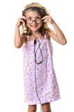 Child girl in glasses with headphones Royalty Free Stock Photos