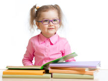 Child girl in glasses reading book royalty free stock images