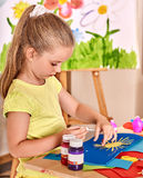 Child girl  glue in preschool Royalty Free Stock Images