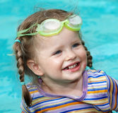 Child girl in goggles swimm pool. Stock Images