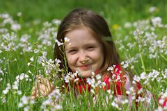 Child girl on a grass Royalty Free Stock Photo