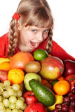 Child girl with group of fruit. Stock Image