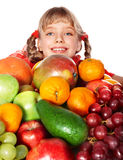 Child girl with group of fruit. Royalty Free Stock Image