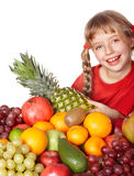Child girl with group of  fruit. Royalty Free Stock Photo