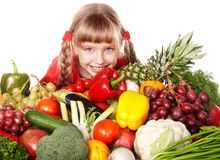 Child girl with group of vegetable and fruit. Royalty Free Stock Images