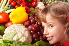 Child girl with group of vegetable and fruit. Stock Image