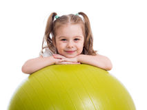 Child girl with gymnastic ball isolated Royalty Free Stock Photos