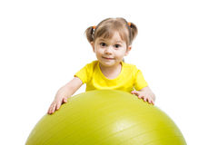 Child girl with gymnastic ball isolated on white background Stock Images