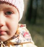 Child girl half face portrait. Closeup outdoor Royalty Free Stock Photos