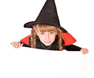 Child girl in Halloween witch costume with banner. Stock Image
