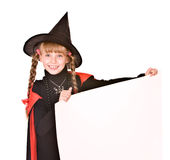 Child girl in Halloween witch costume with banner. Stock Photo