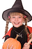 Child girl Halloween witch with pumpkin,broom Royalty Free Stock Image