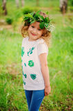 Child girl in handmade wreath and shirt with leaf prints, summer nature craft concept Royalty Free Stock Photos