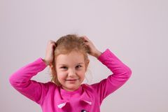 Child girl hands holding head. Amazed or surprised child girl hands holding head Royalty Free Stock Photo