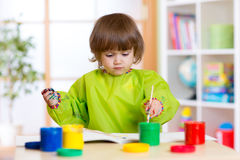 Child girl with hands painted color paints Royalty Free Stock Photo