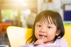 Child girl happy eating snack crispy crunches Royalty Free Stock Photography