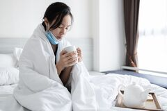 Free Child Girl Has Flu Fever Feel Cold And Shivery During COVID-19,Coronavirus Pandemic,holding Cup Of Warming Drink,hot Tea Under Stock Image - 194624331