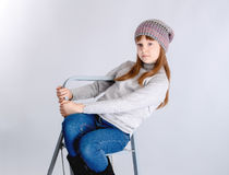 Child girl hat. Adorable smiling child girl wearing grey knitted hat Stock Photography