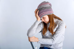 Child girl hat. Adorable smiling child girl wearing grey knitted hat Stock Image