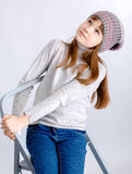 Child girl hat. Adorable smiling child girl wearing grey knitted hat Stock Photo