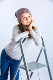 Child girl hat. Adorable smiling child girl wearing grey knitted hat Stock Photos