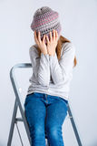 Child girl hat. Adorable smiling child girl wearing grey knitted hat Royalty Free Stock Photos
