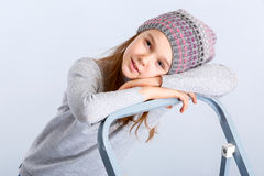 Child girl hat. Adorable smiling child girl wearing grey knitted hat Royalty Free Stock Photography