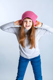 Child girl hat. Adorable smiling child girl wearing pink knitted hat Stock Photography