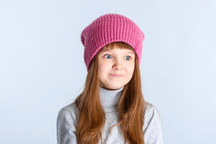 Child girl hat. Adorable smiling child girl wearing pink knitted hat Stock Images