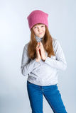 Child girl hat. Adorable smiling child girl wearing pink knitted hat Stock Image