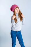 Child girl hat. Adorable smiling child girl wearing pink knitted hat Stock Photos