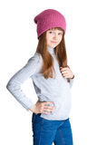 Child girl hat. Adorable smiling child girl wearing pink knitted hat Royalty Free Stock Photos