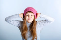 Child girl hat. Adorable smiling child girl wearing pink knitted hat Stock Photo