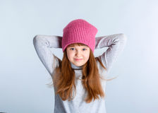 Child girl hat. Adorable smiling child girl wearing pink knitted hat Royalty Free Stock Photography