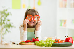 Child girl having fun with food vegetables at nursery room Royalty Free Stock Image