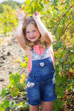 Child girl having fun in grape vineyard Royalty Free Stock Photo
