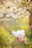 Child girl is having fun in hammock on the nature Stock Photo