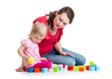 Child girl and her mom play with building blocks Stock Photography