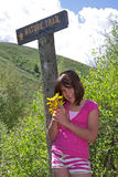 Child (girl) hiking and picking wildflowers. Child (girl) picking wildflowers on a nature trail Royalty Free Stock Photos