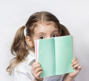 Child girl hold note book empty pages.Message communication conc Royalty Free Stock Photo