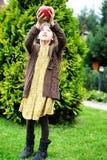 Child girl holding big apple Stock Image