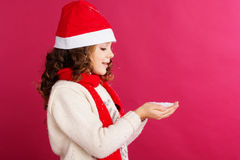 Child girl is holding fake snow in hands Stock Photos