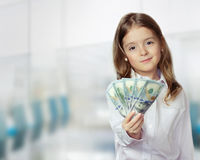 Child girl holding money in hands financial background. Royalty Free Stock Images
