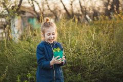 A child girl holding a pot of seedlings stock photos